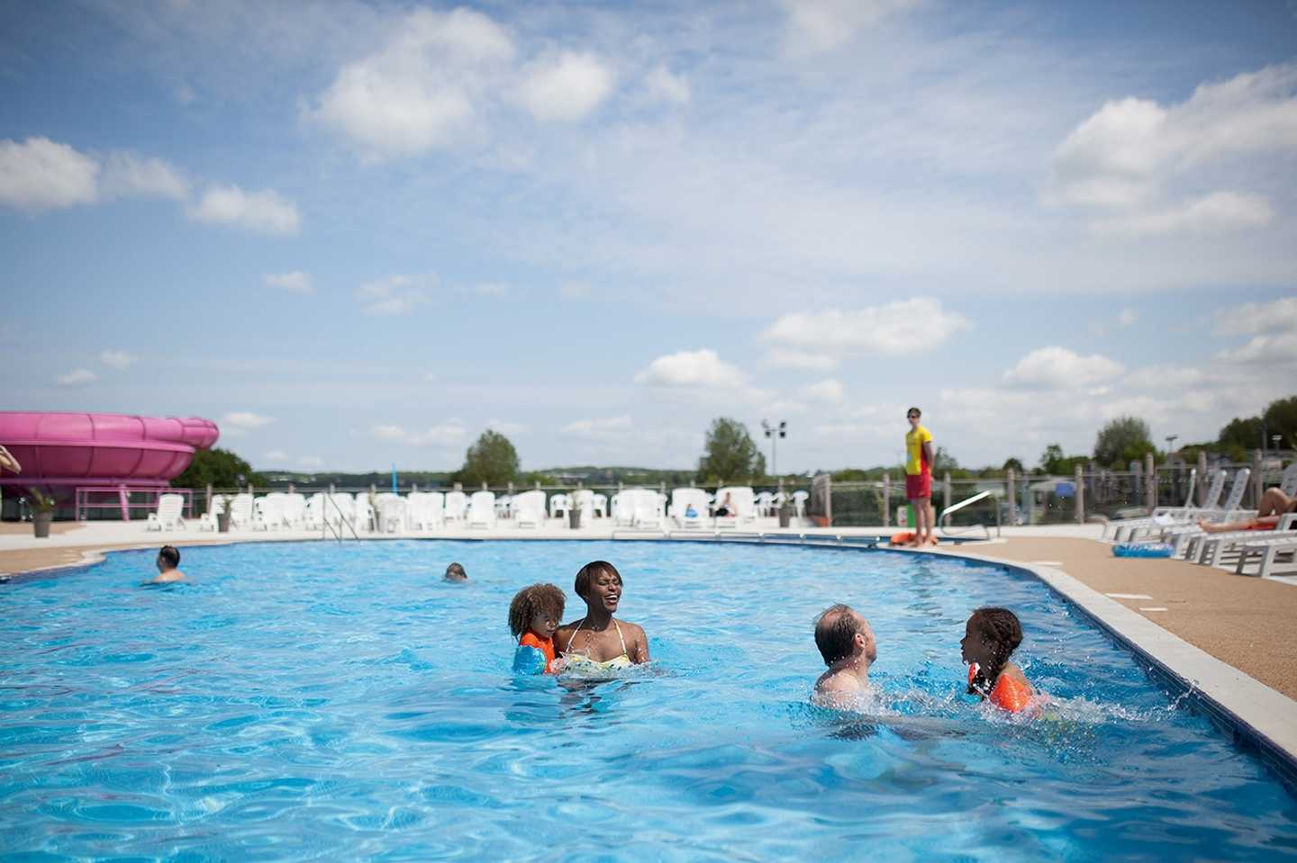 Guests playing games in the outdoor pool