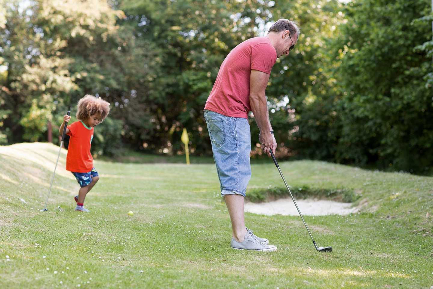 Family playing Pitch and Putt