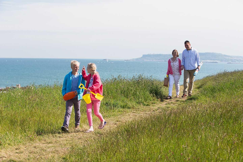 A family walking along Seaview's nature walk