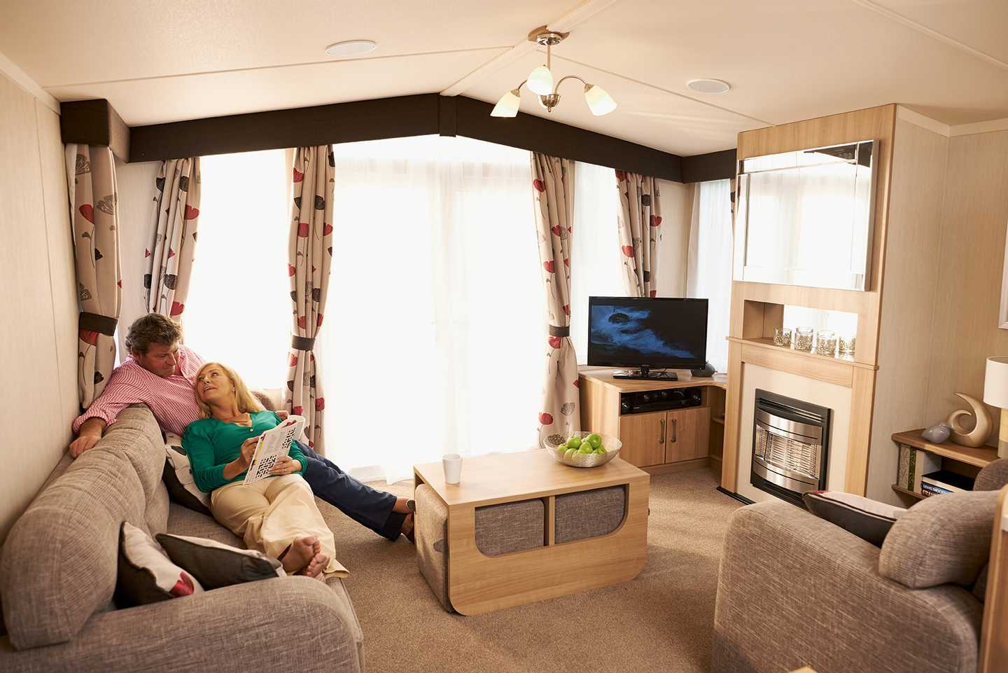 A couple relaxing in a caravan lounge