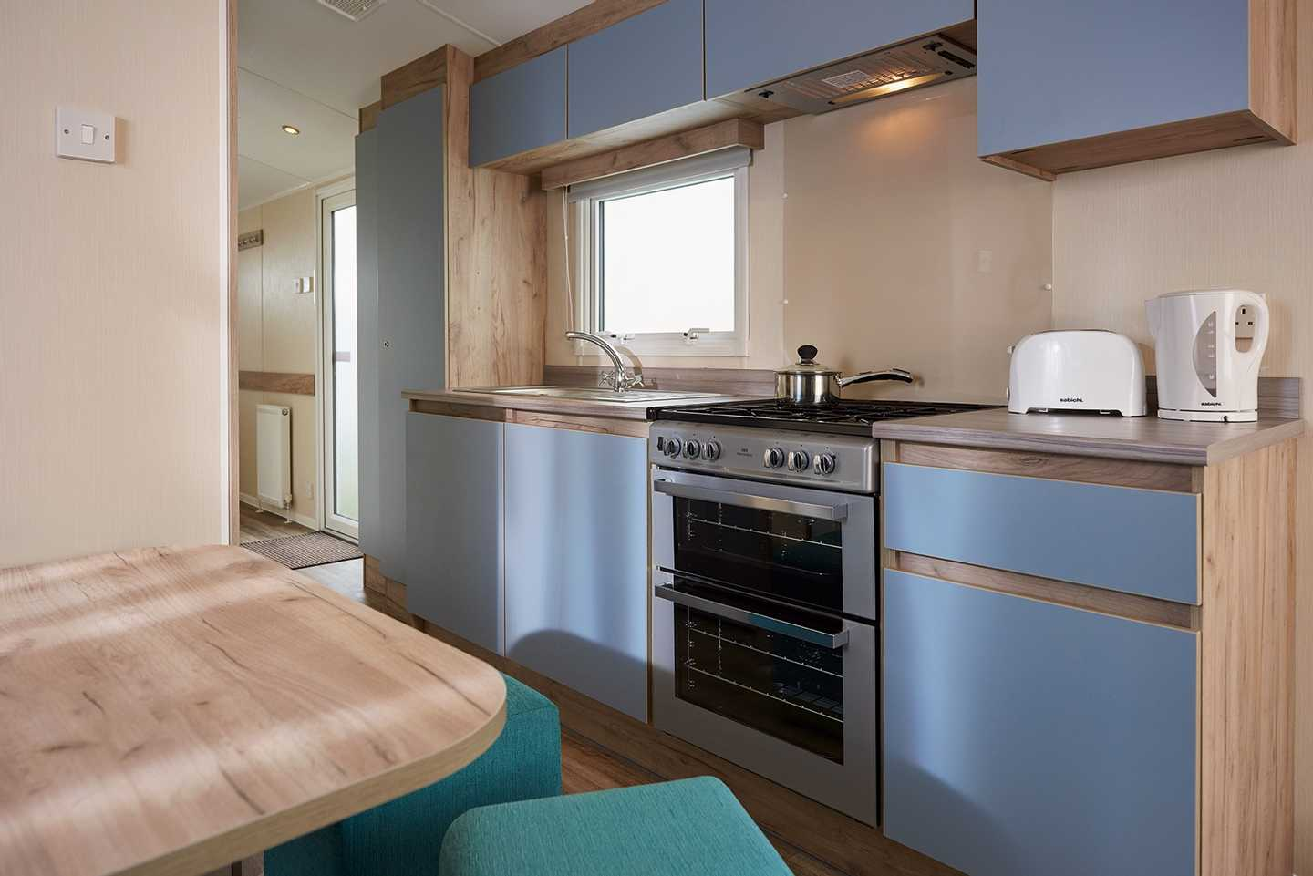 A newer Standard caravan kitchen with cooker, toaster and kettle