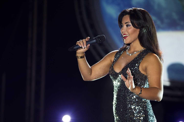 Glamorous female singer performing