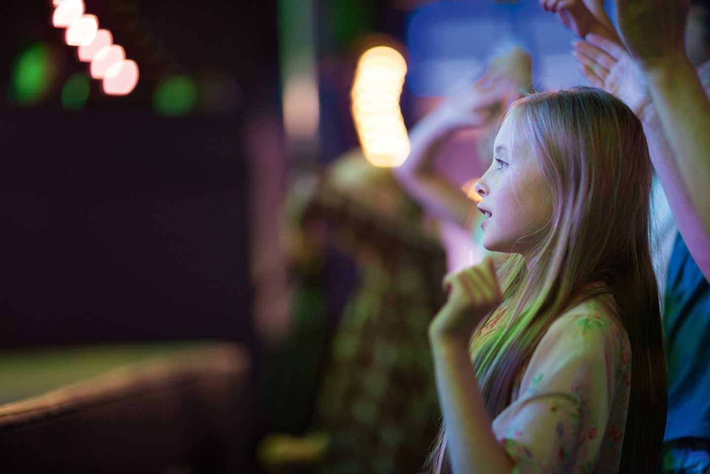 A child enjoying the entertainment