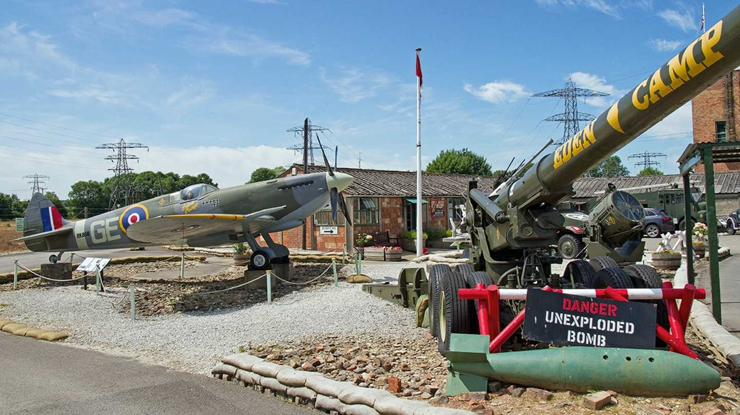 Military aircraft and vehicle at Eden Camp