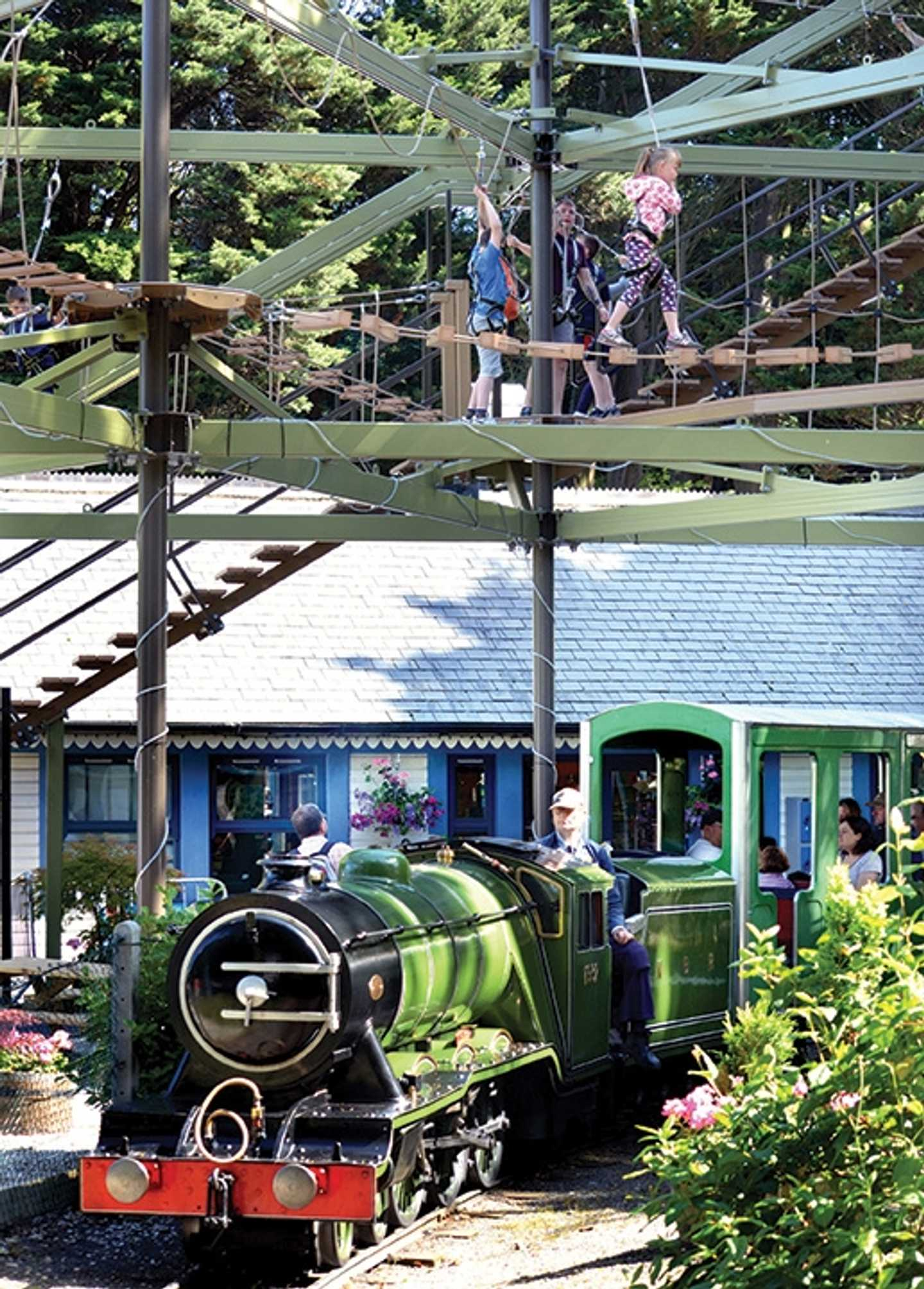 Children on the sky trail above a train ride
