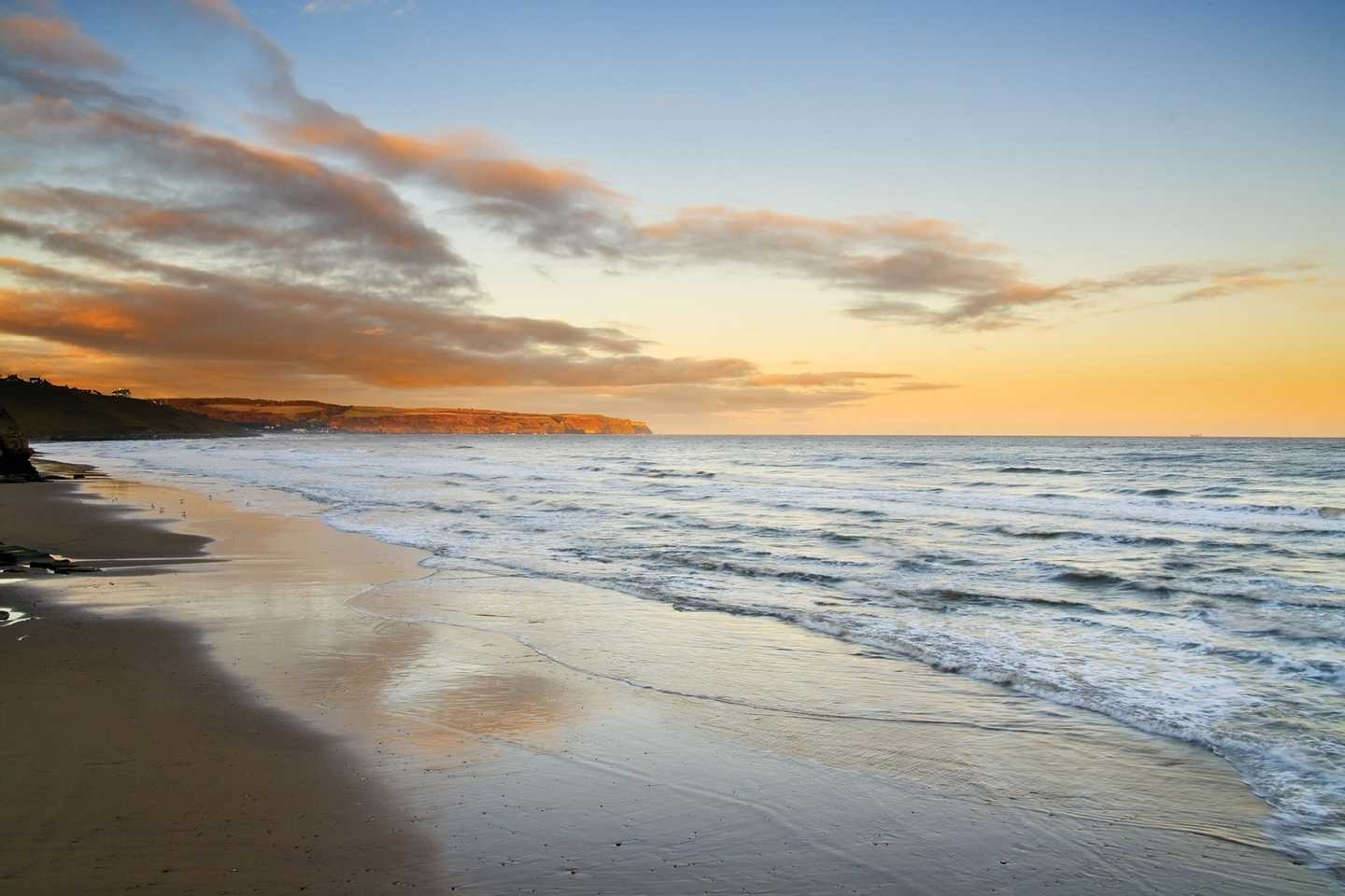 Golden sand, blue sea and sunset at Whitby Beach