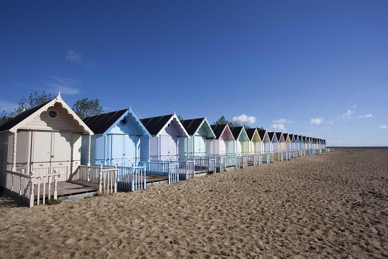 Row of beach huts on West Mersea beach in Essex