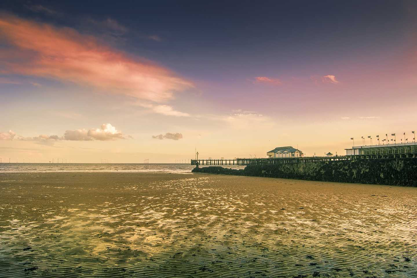 A sunset with Clacton-on-Sea pier in the distance