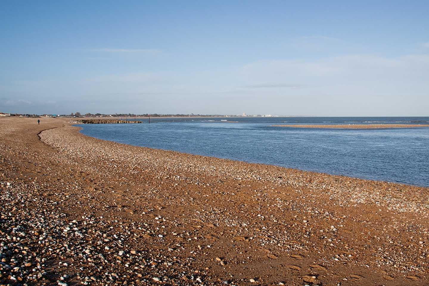 Panoramic view of shingle beach and shore, Pagham Harbour