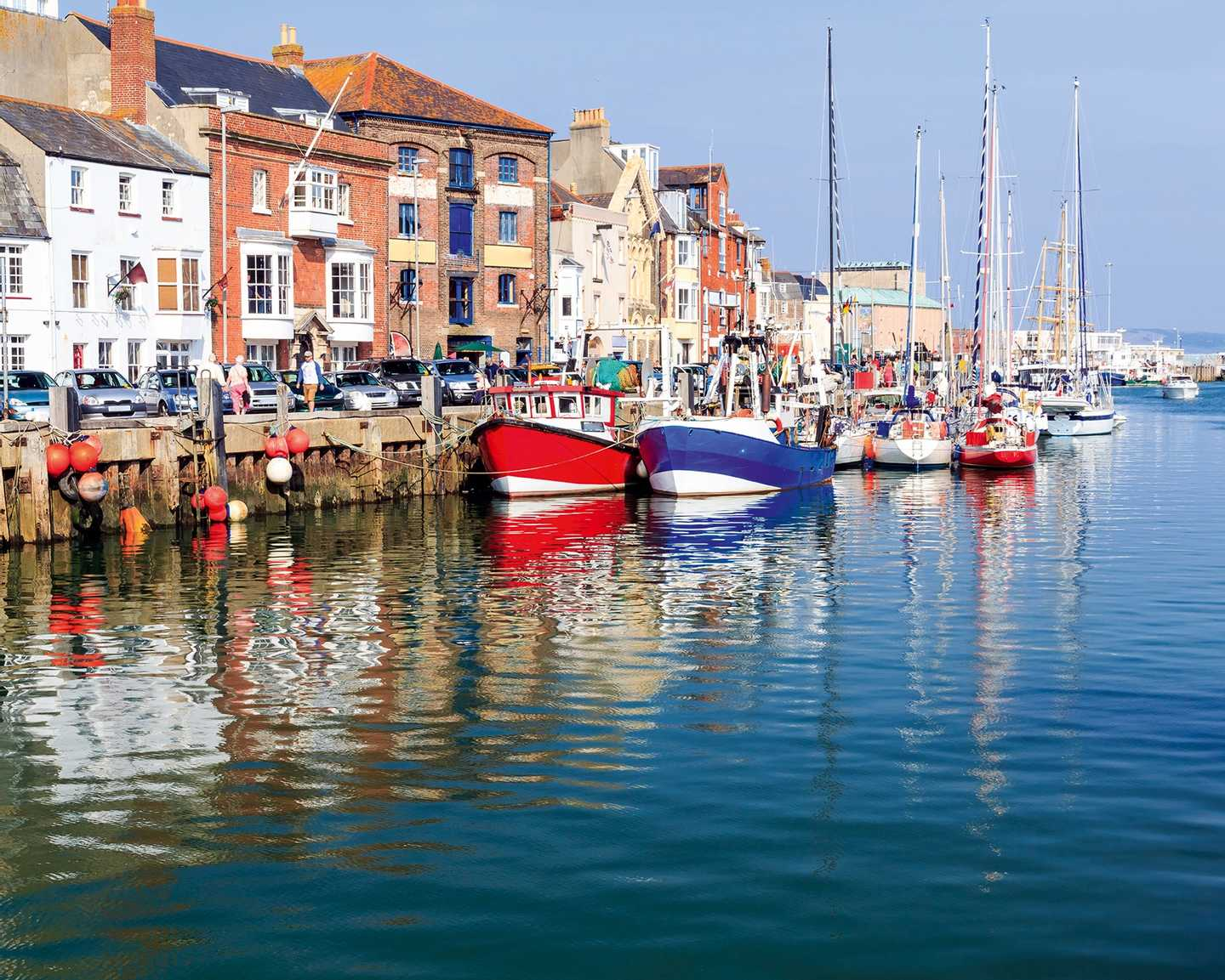 Colourful houses and boats along Weymouth Harbour