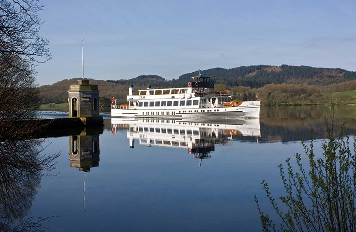 A white riverboat on Windermere Lake
