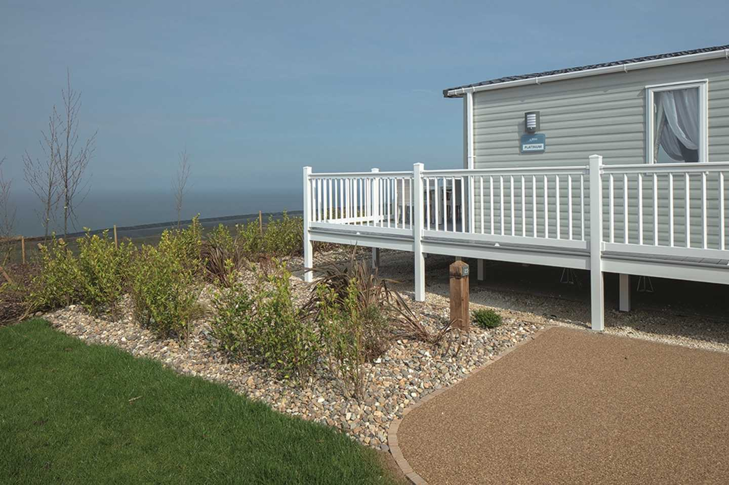 Representation of a Prestige with decking at The Lakes