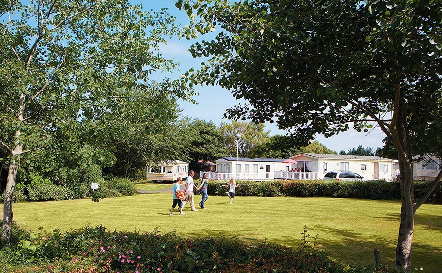 Guests playing outside their caravan at Seton Sands, Scotland