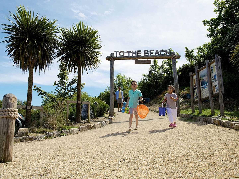 Family walking from the beach at Kiln Park