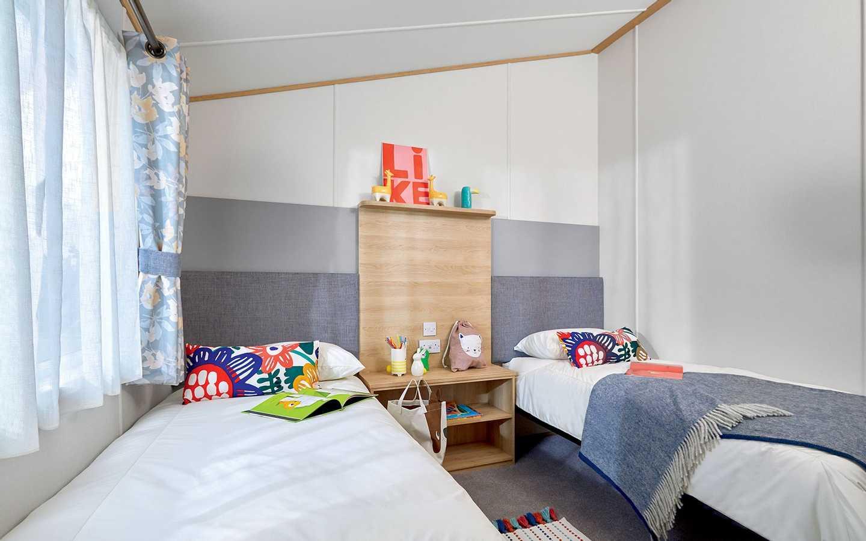 Luxury Lodge twin bedroom at Elterwater