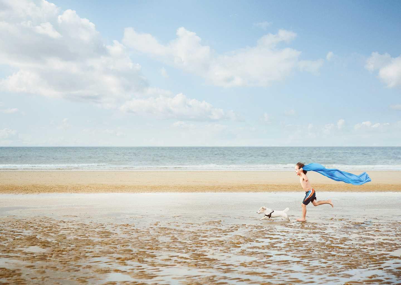 Boy running along the beach