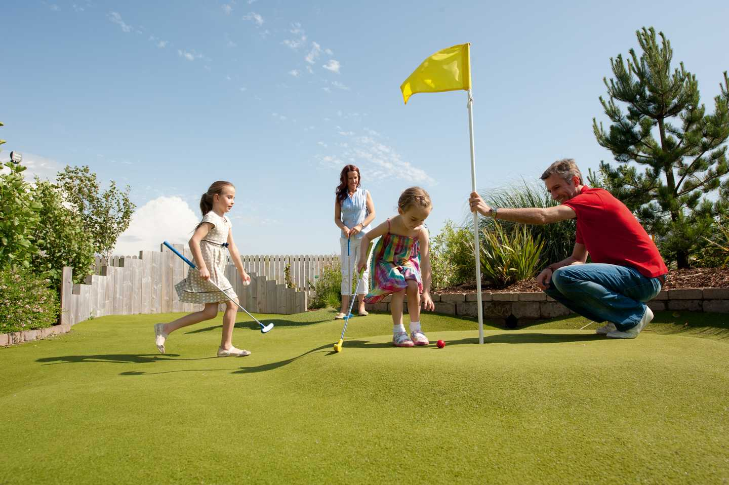 A family playing Adventure golf