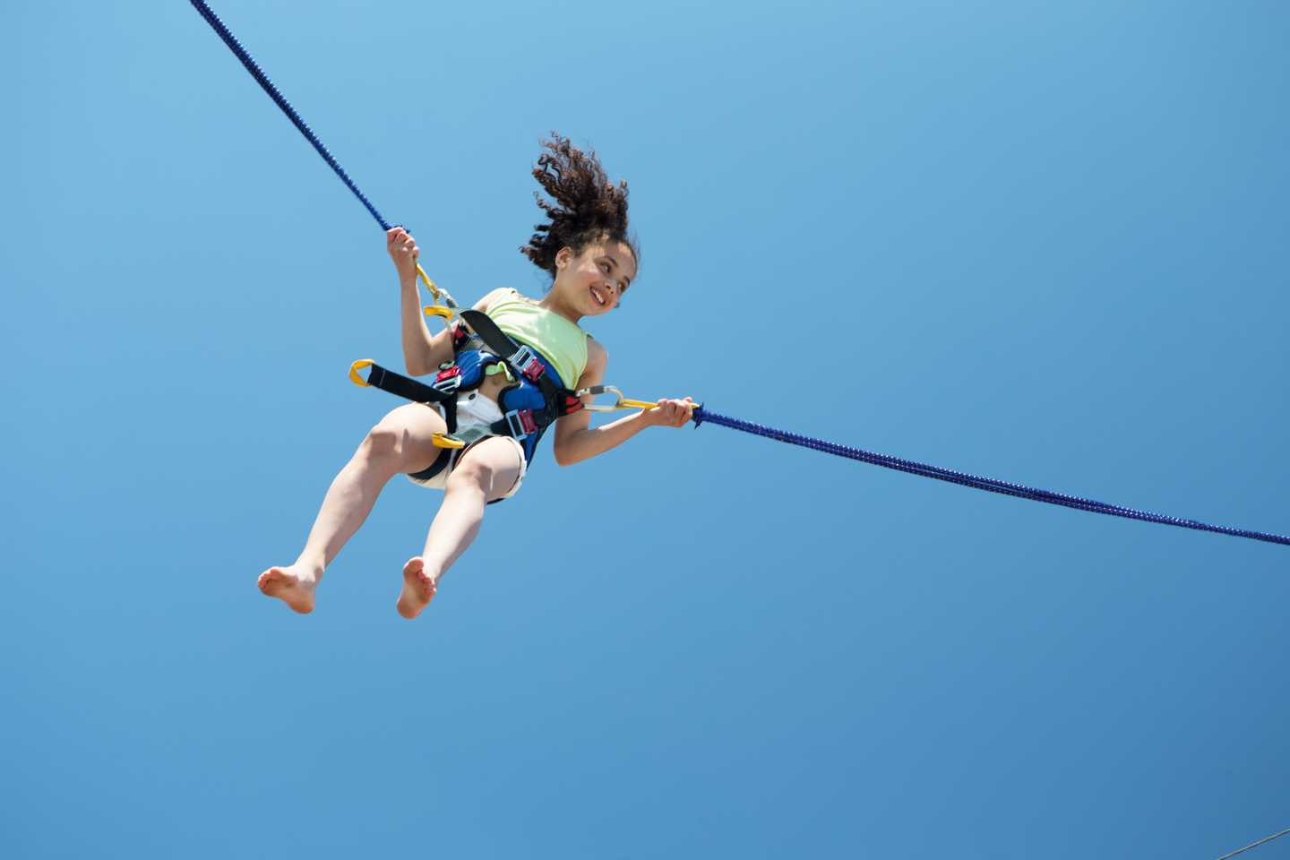 A child on a bungee trampoline