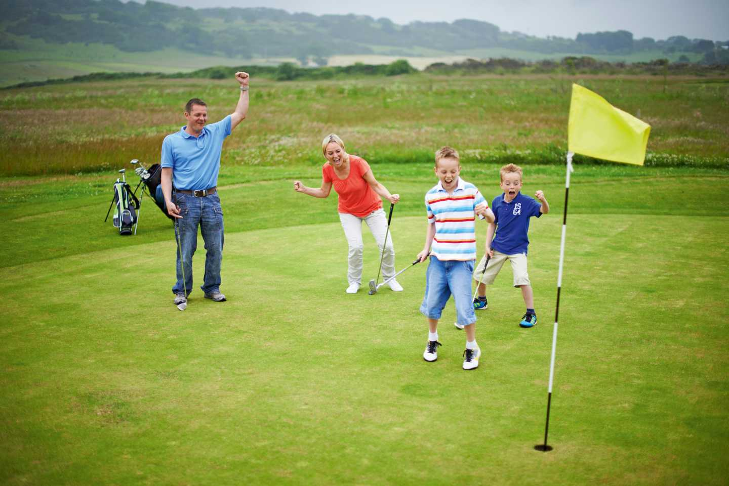 Family putting on the golf green
