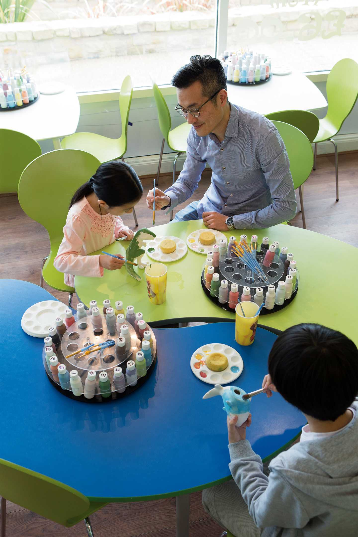 Kids painting pottery