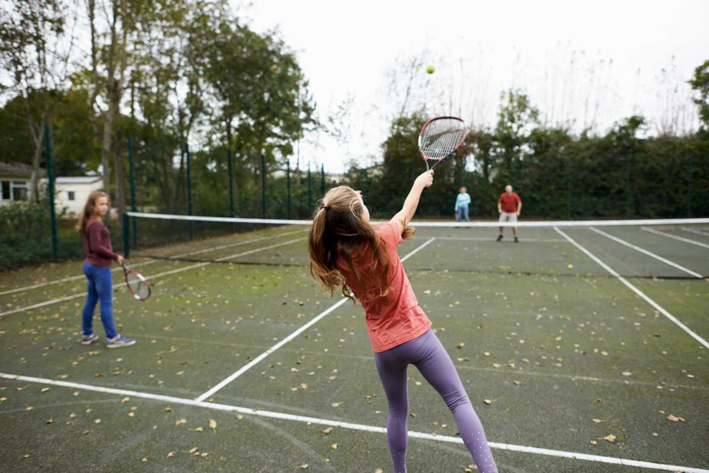 Guests playing tennis at Church Farm