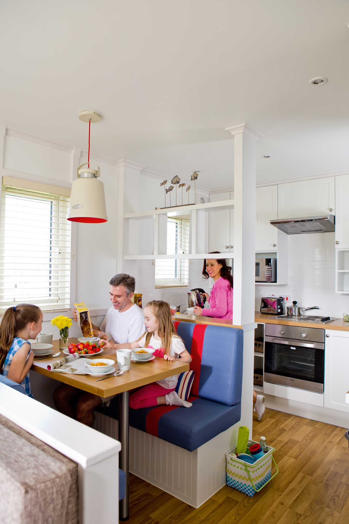 A family eating breakfast in a Comfort with veranda apartment