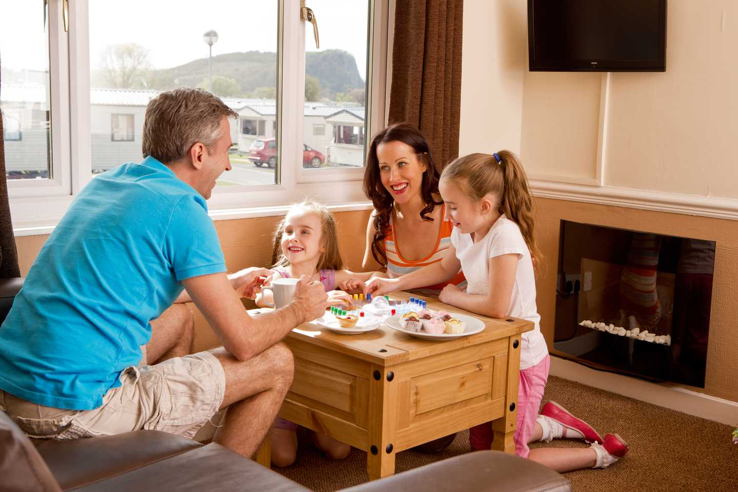 A family playing games in a Standard apartment lounge
