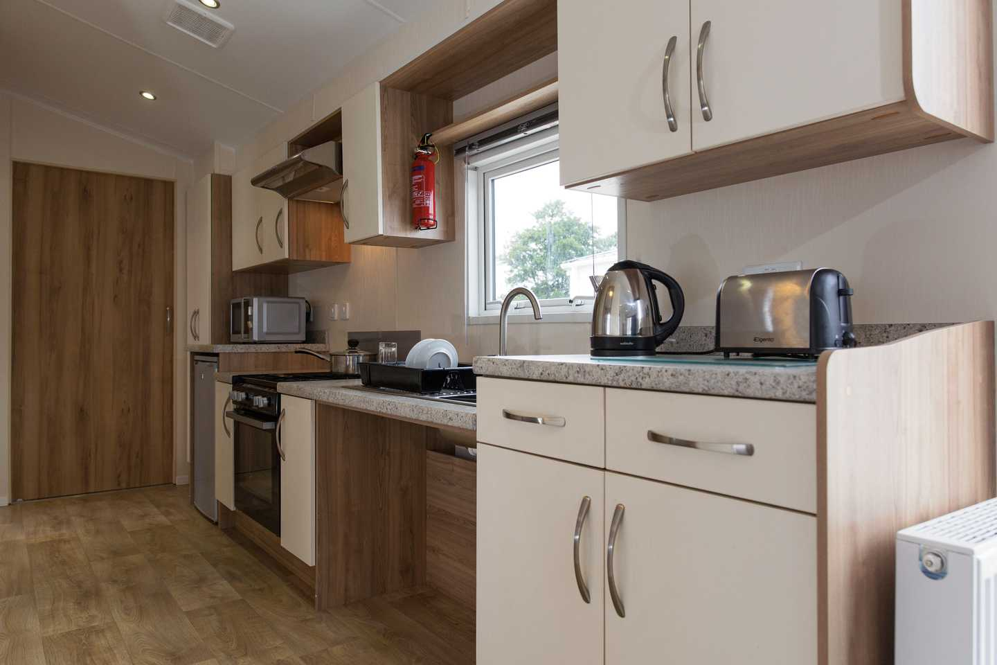 An Adapted caravan kitchen with kettle, toaster and storage