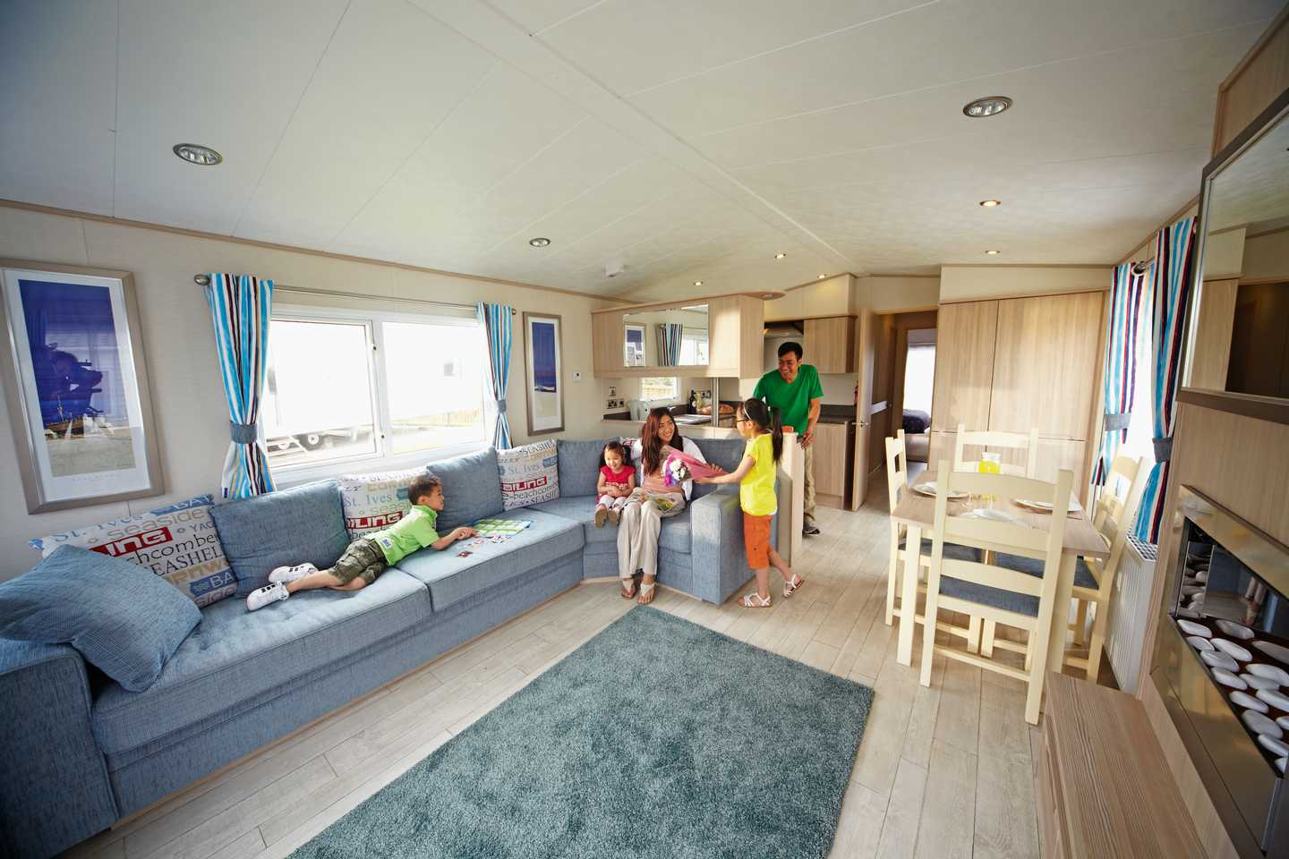 A family relaxing in a Prestige caravan