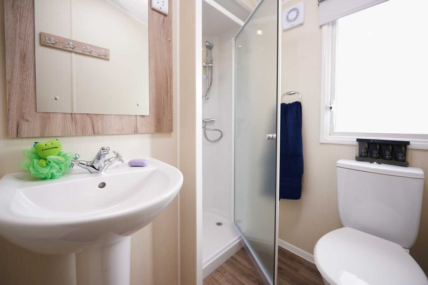 A Standard bathroom with a sink, shower and toilet