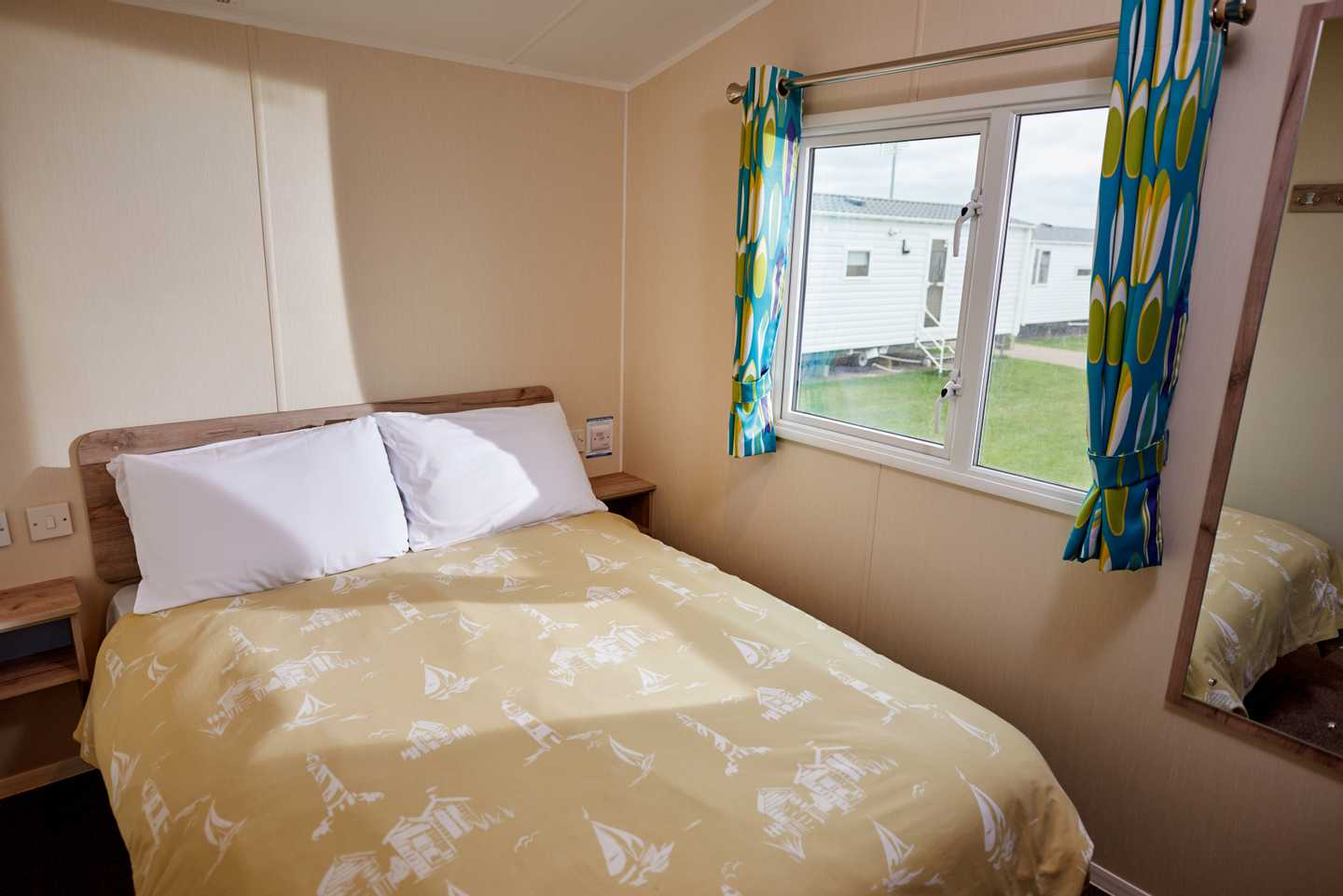 A newer Standard caravan master bedroom