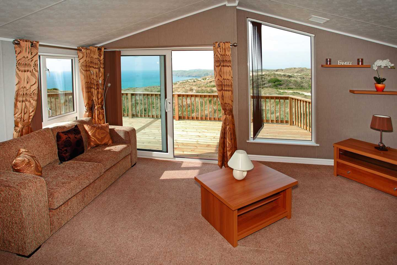 A Luxury Lodge lounge with sliding doors to veranda