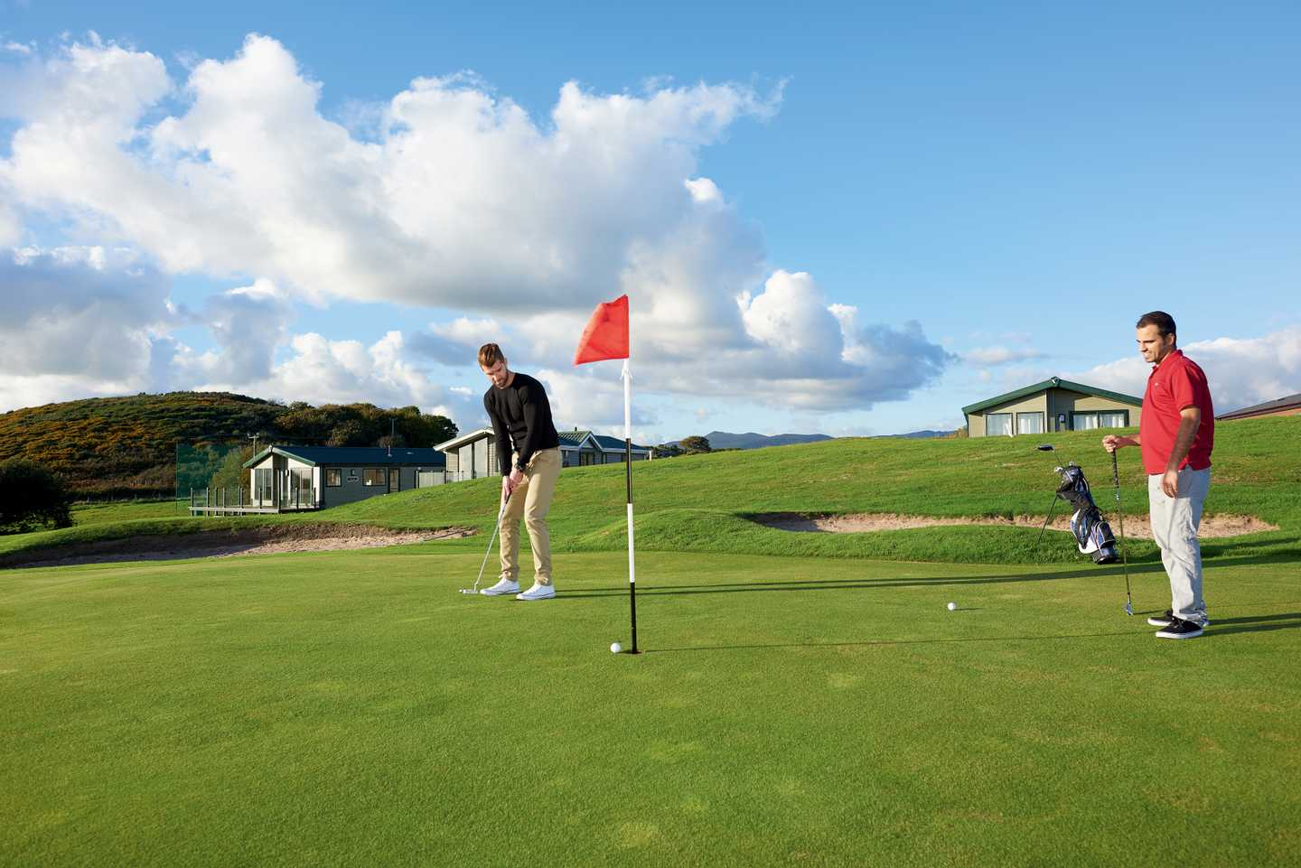 Guests playing golf