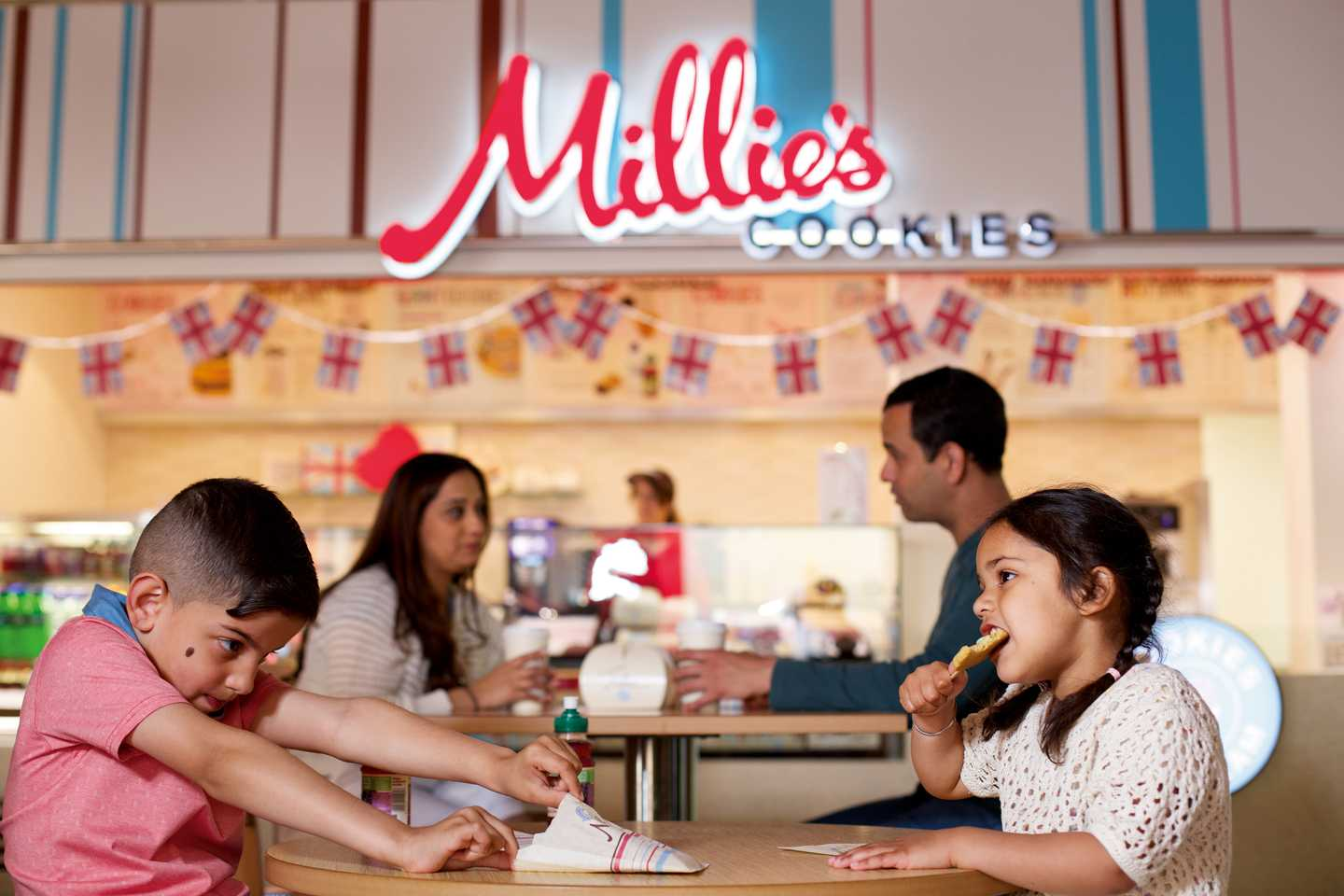 Guests sitting at a table at Millie's Cookies, Kiln Park