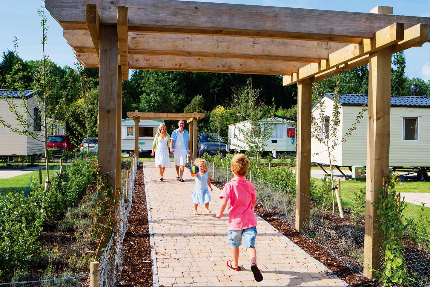 A family walking through a pergola at Kiln Park