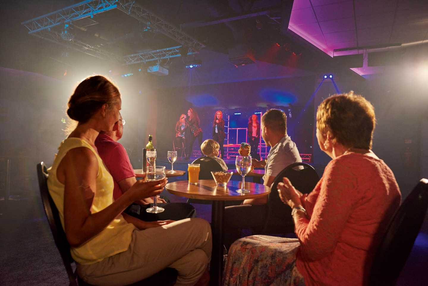 A family watching a show in the ShowBar