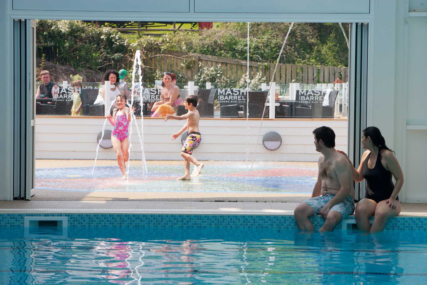 Guests playing in the splash area