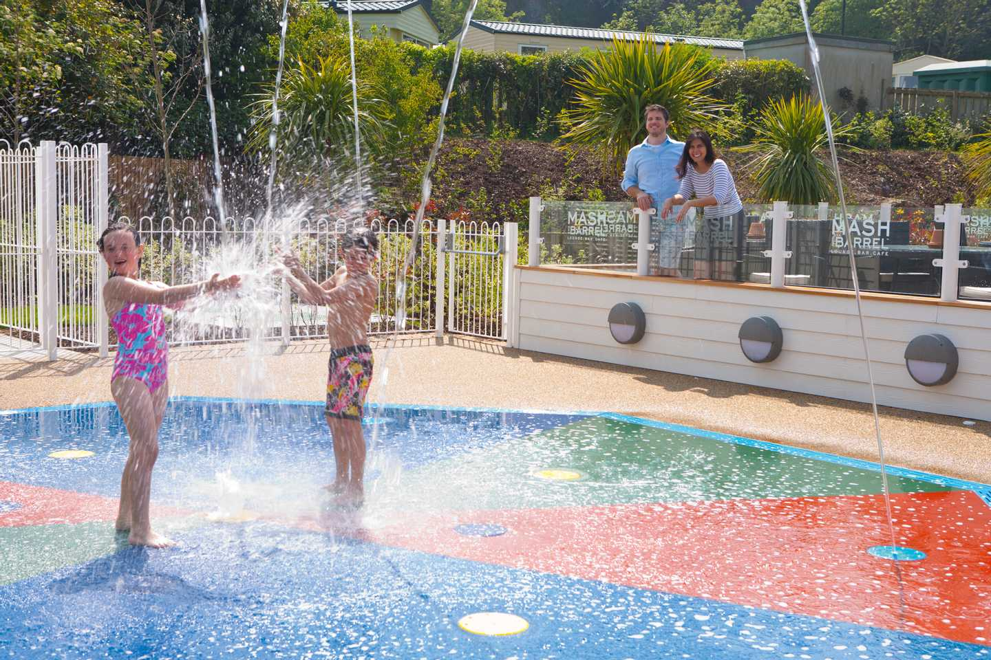 Children splashing around the splash area at Kiln Park
