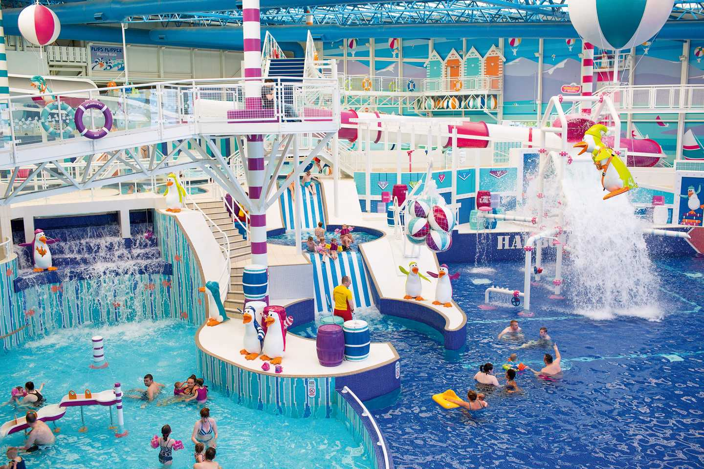 Lots of families enjoying our huge indoor pool complex at Craig Tara Holiday Park which has numerous flumes, slides and plenty of fun features