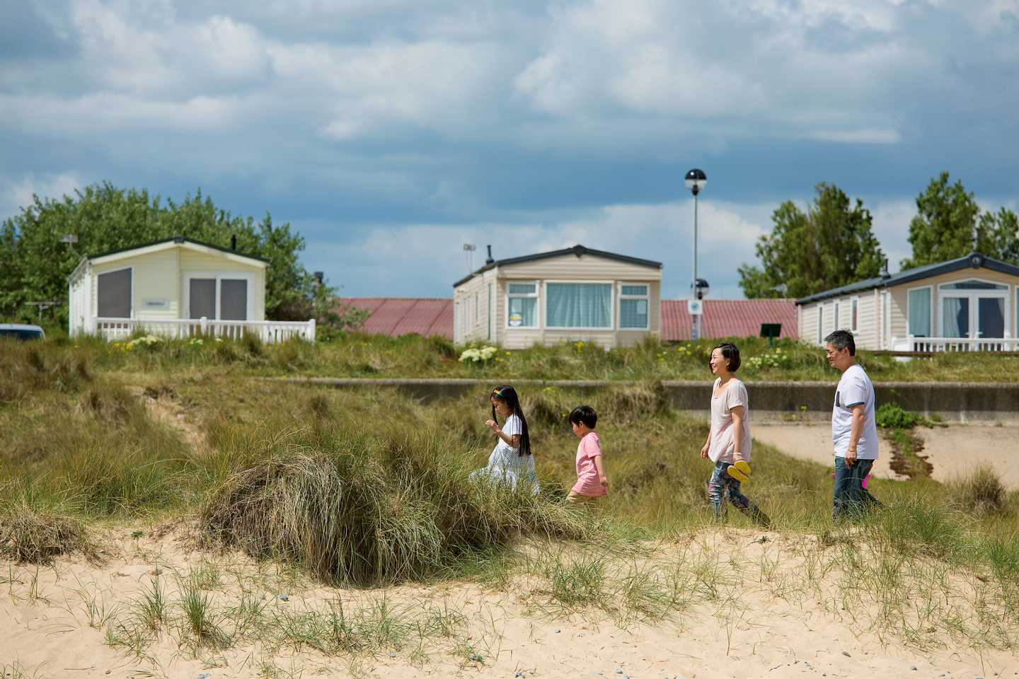 Owners walking beside the beach front accommodation at Seashore