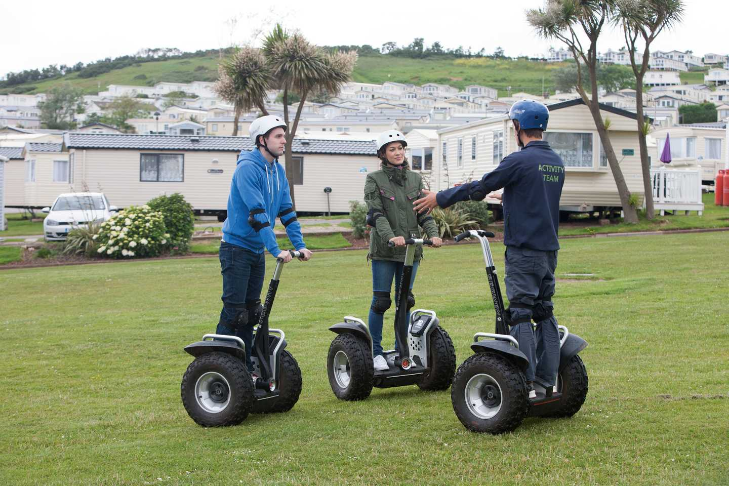Guests riding on a Segway at Devon Cliffs