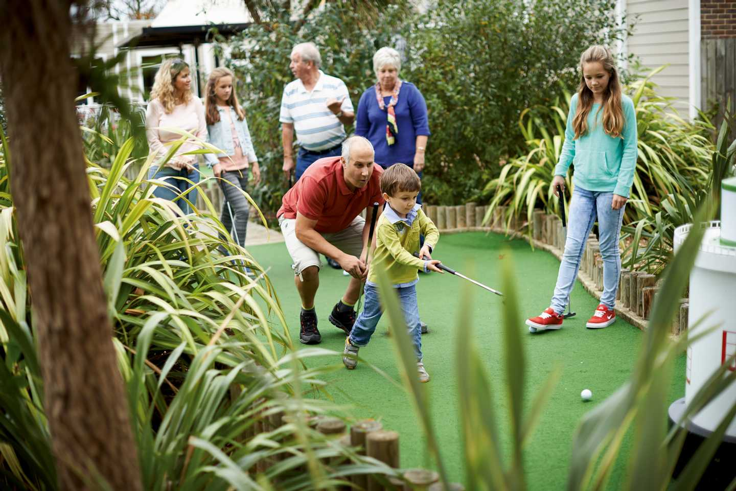 A family playing crazy golf