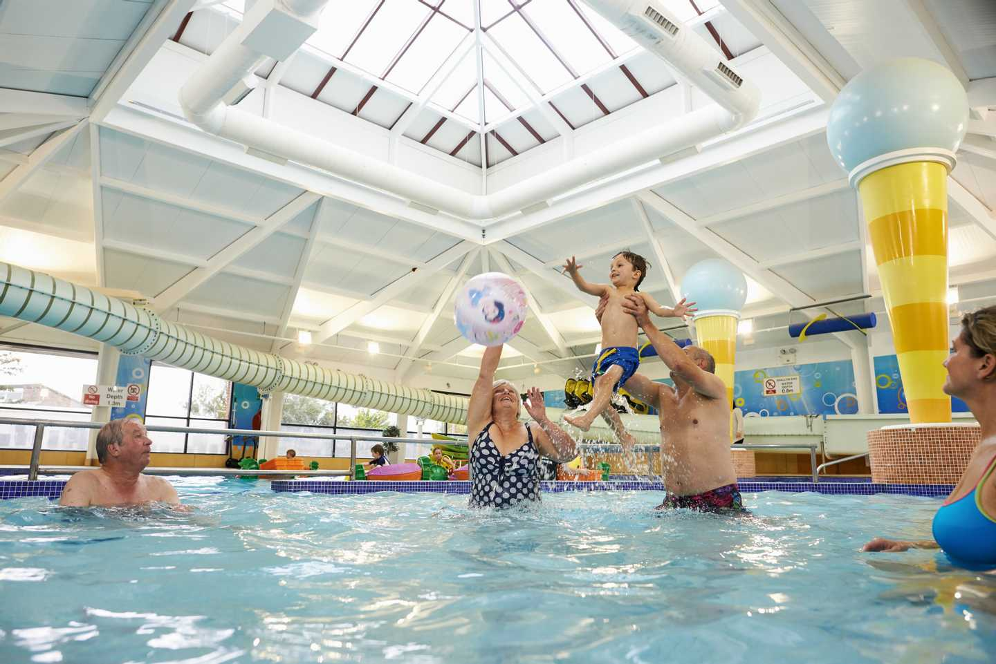 Guests splashing around in the heated indoor pool