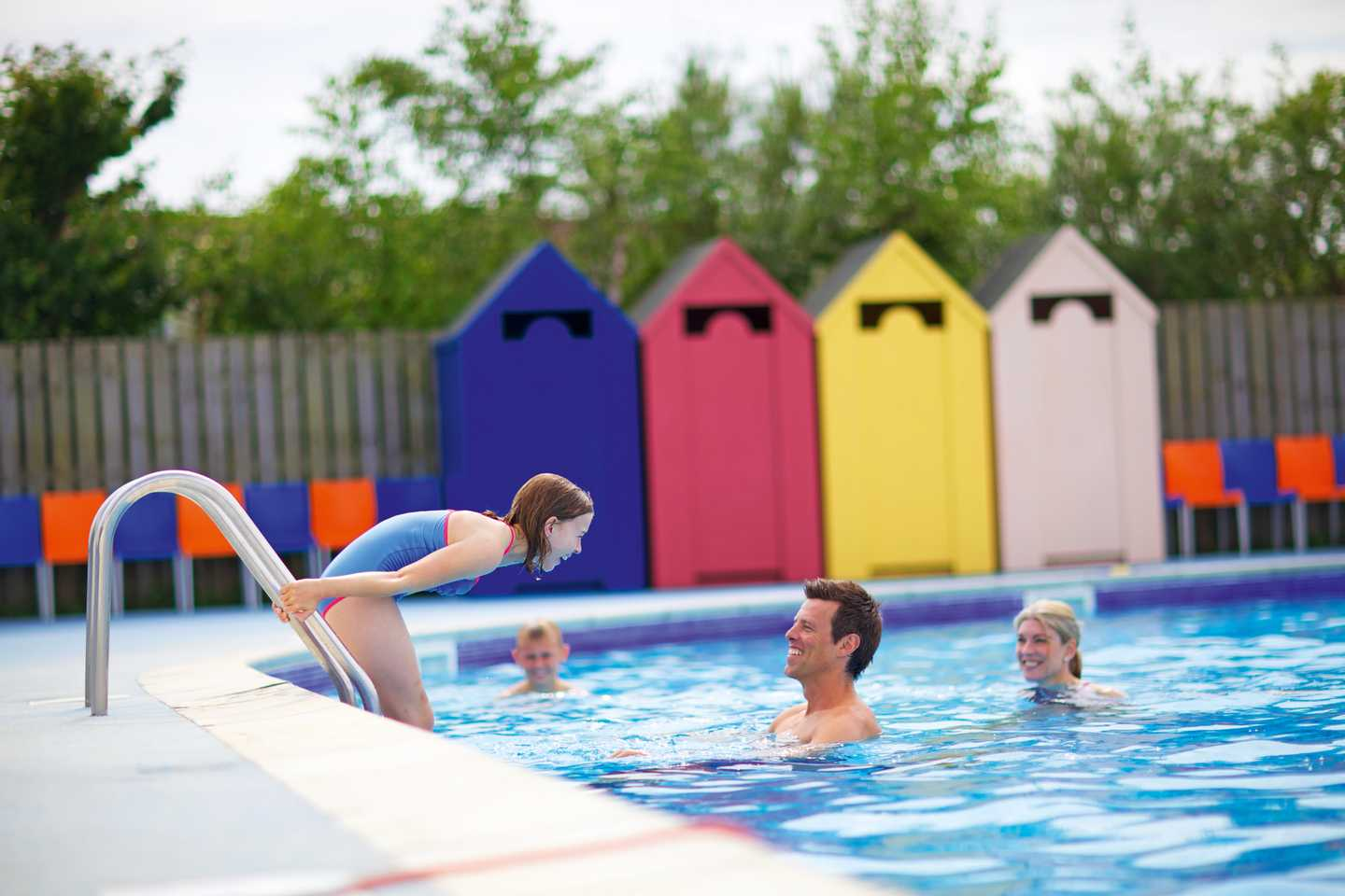 A family playing in the heated outdoor pool