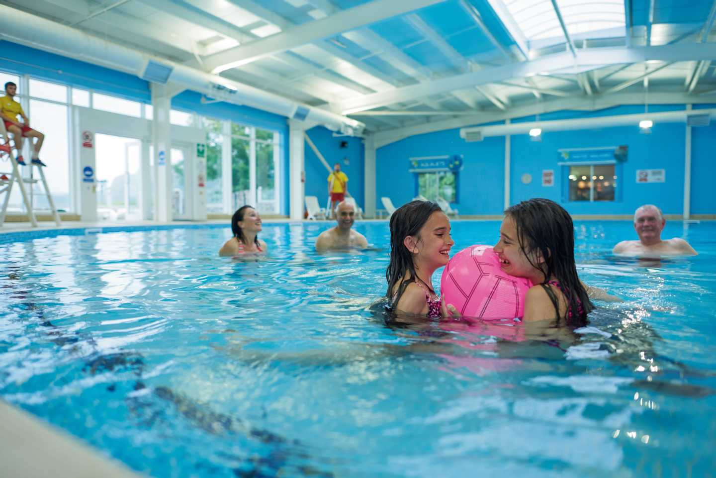 Guests playing ball games in the heated indoor pool