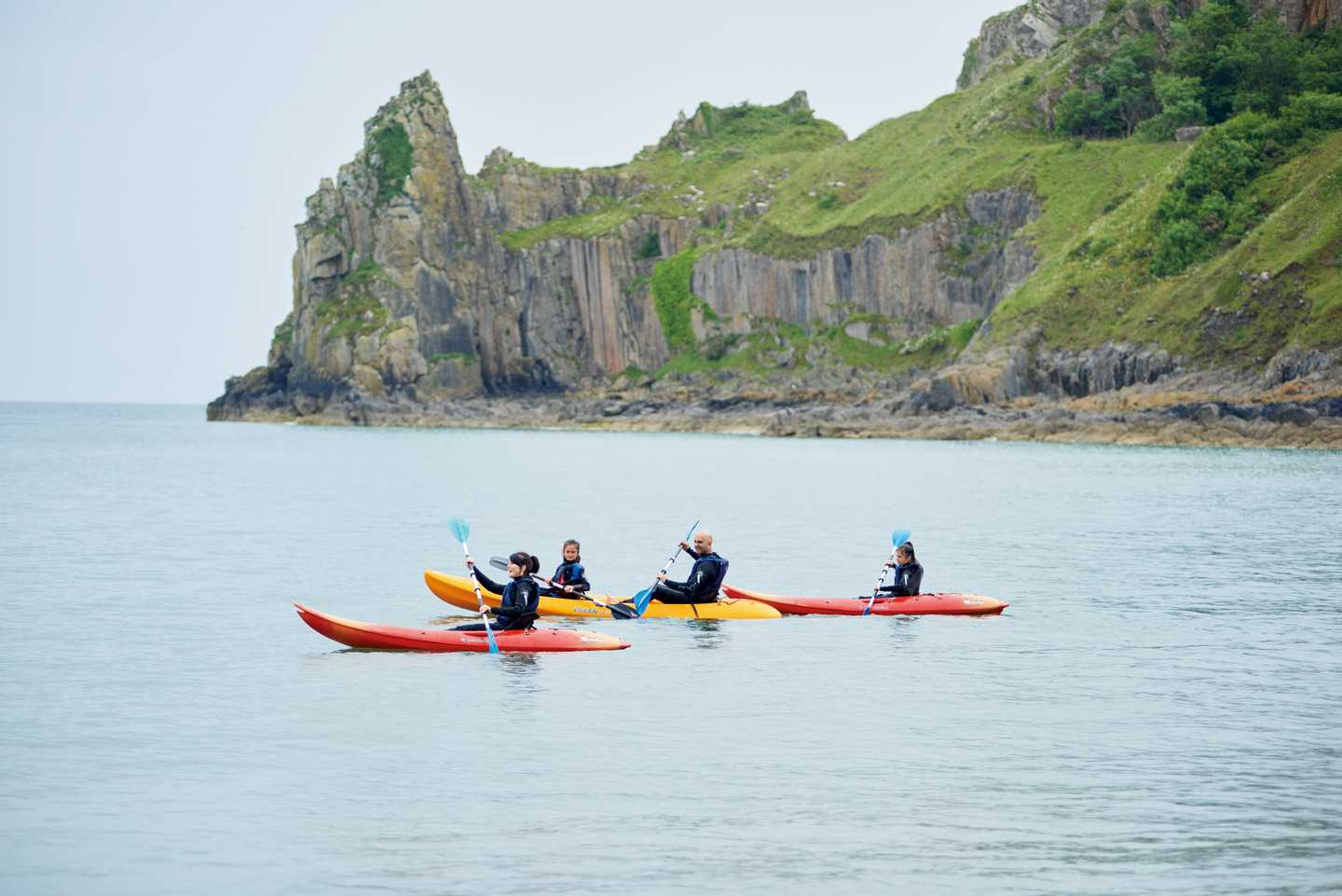 Guests kayaking in the sea at Lydstep Beach