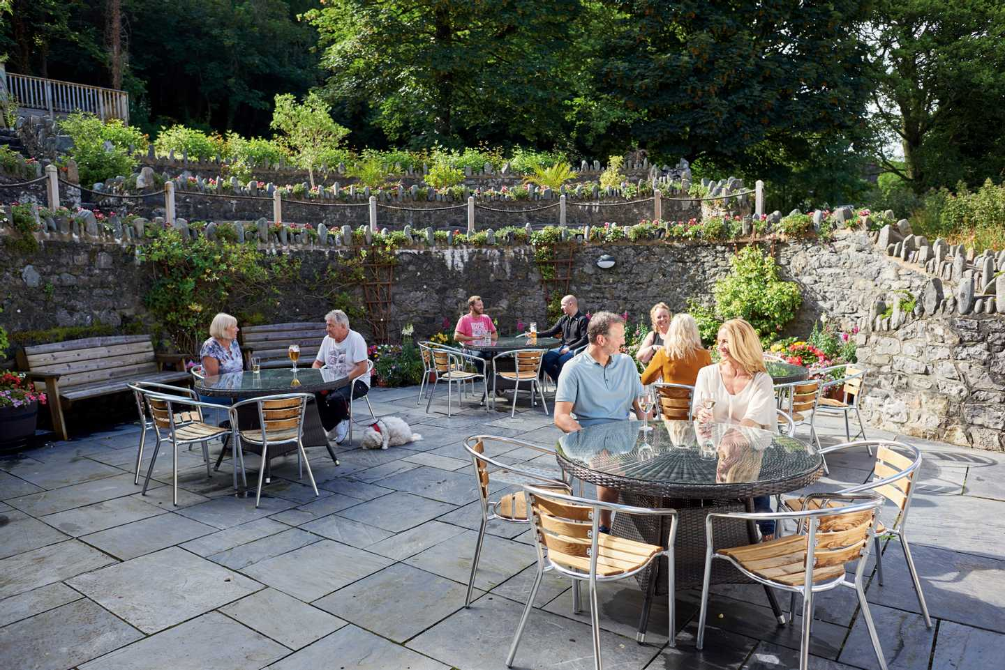 Guests in the back terrace area of The Manor House at Lydstep Beach