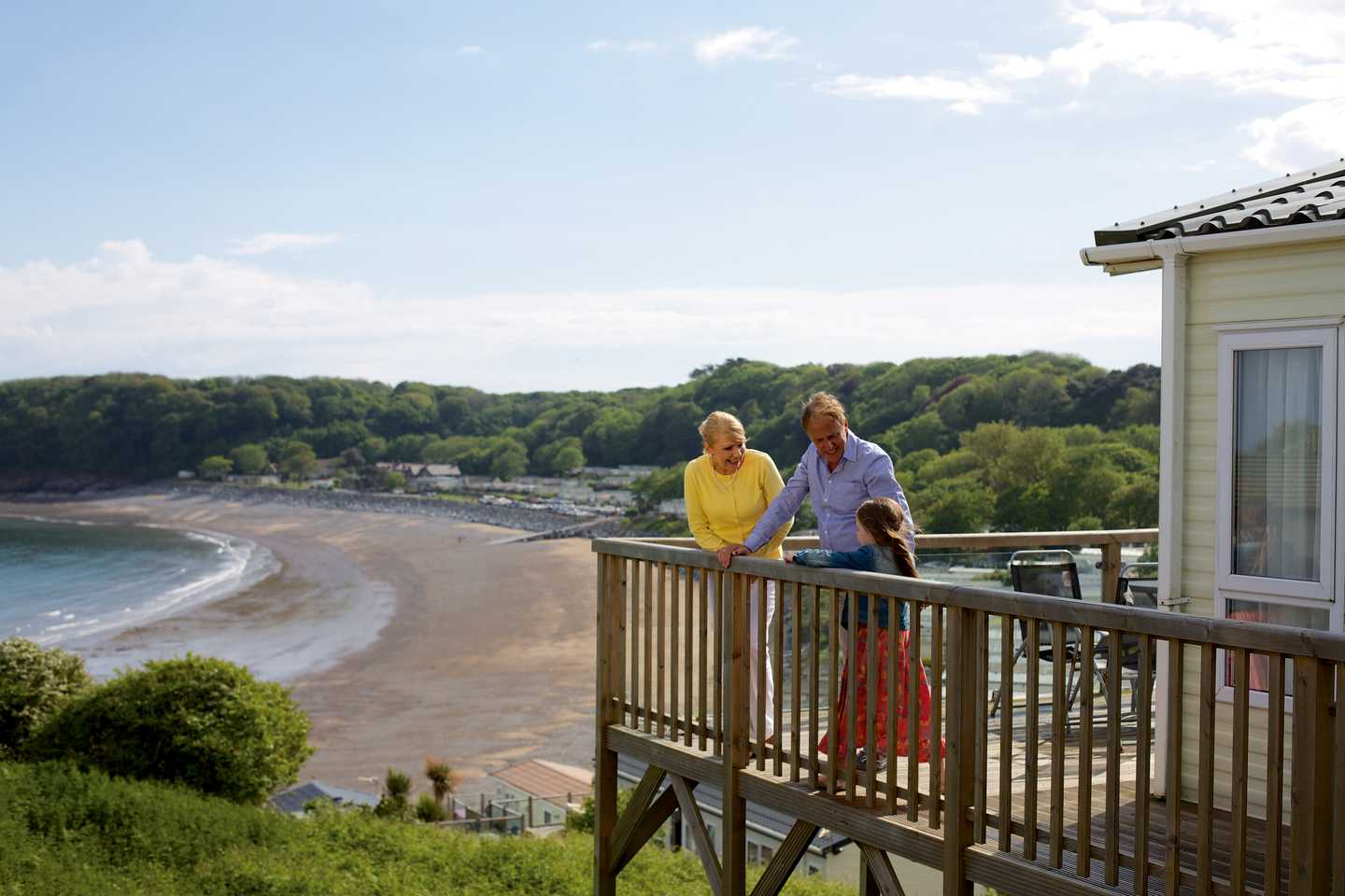 Owners standing on their veranda looking out to sea
