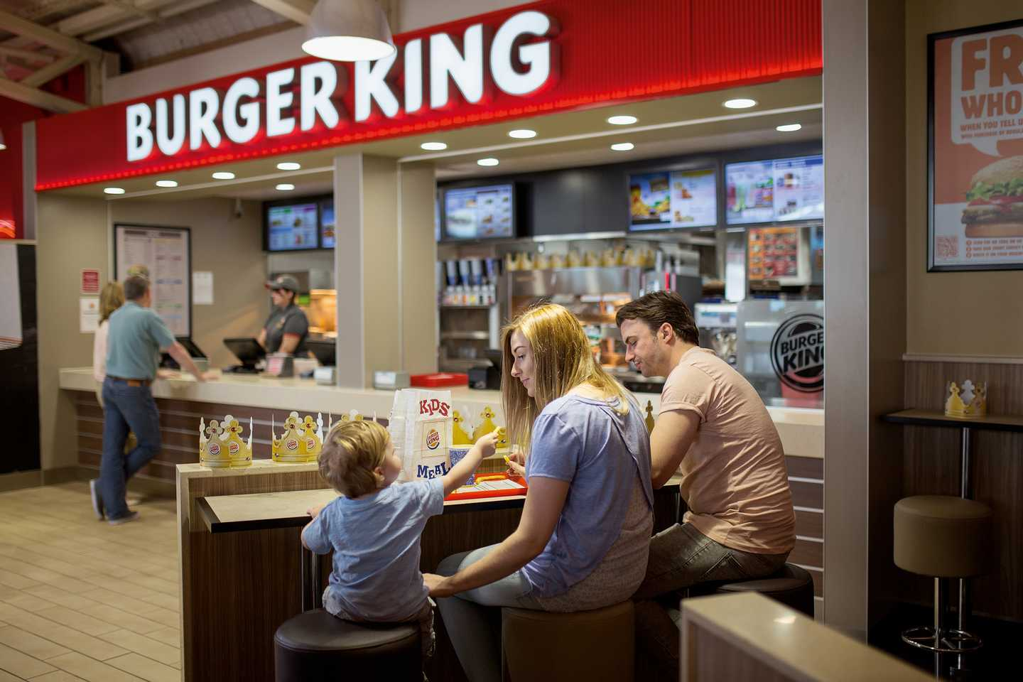 A family seated outside BURGER KING®