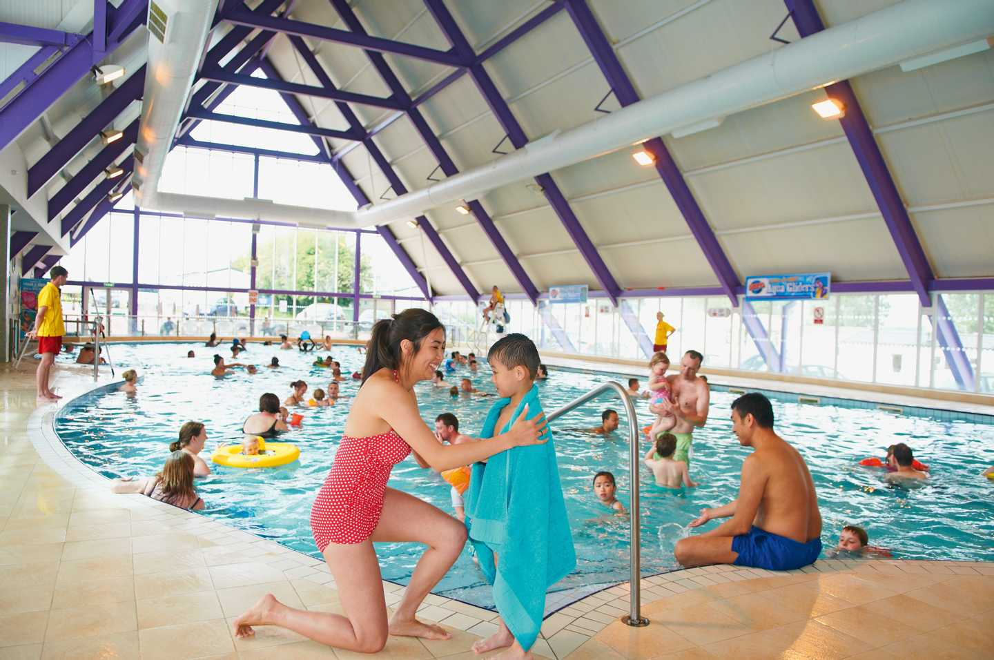 Families splashing around in the heated indoor pool